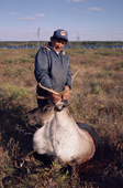 Abel Brien, a Cree hunter with a caribou he has shot. Sub-Arctic, Quebec, Canada. 1988
