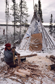 Elizabeth Brien, a Cree woman chops firewood at the family's winter camp at Lake Bourinot. Canada. 1988