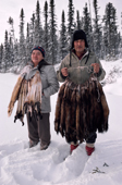 A Cree trapper and wife, Abel & Elizabeth Brien, with pelts of autumn catch of Pine Martens, Quebec, Canada. 1988
