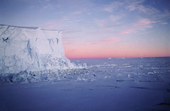 Edge of the Ice shelf at 3.00am, sea ice and a sunrise. Antarctica.