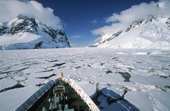 Ice strengthened cruise ship in the close pack of the Lemaire Channel. Antarctic Peninsula.