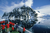 Ice strengthened cruise ship in the Lemaire Channel, one of the most beautiful places. Antarctic Peninsula.