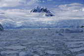 The dramatic beauty of the Lemaire Channel, mountains, glaciers and sea ice. Antarctic Peninsula.