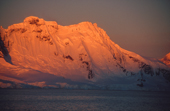 Sunset glow on mountains in Peninsula area. Antarctica.