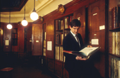 Rupert Fisher, secretary to the York Herald, doing research in the Record Room at the College of Arms.