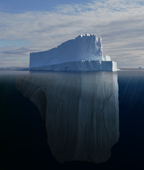 Tabular Iceberg showing the portion underwater that is sculpted by the sea. Polar regions. Digital composite.