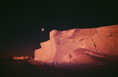 The ice cliffs of the Brunt Ice Shelf, and moon lit by the faint glow of the absent sun. Antarctica.