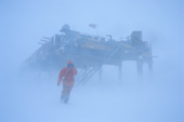 Venturing outside in 50 knots & blowing snow at Halley Research Station, Brunt Ice Shelf. Antarctica.