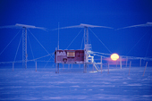 Rising moon behind the Southern Hemisphere Auroral Radar Experiment (SHARE) at Halley Research Station, Antarctica, after the sun has set for winter.