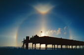 22 sun halo, with sun pillar, sun streak, Lowitz arcs, Upper Tangent Arc and Parry Arc at the top of the halo, all caused by diamond dust in the air above Halley Research Station, Brunt Ice Shelf. Antarctica.
