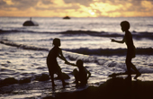 Children playing on the beach at sunset. Anibare Bay. Nauru. The Pacific.