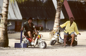 Two Nauruan men on motorcycles. Nauru. The Pacific.
