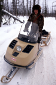 Andrei Dulubchin, an Evenk man out hunting in the taiga on a snowmobile. Evenkiya, Siberia, Russia. 1997