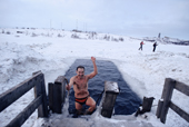A bather from the Walrus Club swimming in a hole in the ice covering Lake Semyonovskaya. Murmansk,  NW Russia. 2005