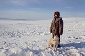 Olga Kirillova, a Sami woman from Lovozero, with her dog at reindeer winter pastures. Kola Peninsula, Murmansk, NW Russia. 2005