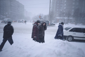 Residents in the centre of Murmansk during a winter snow storm. Kola Peninsula, NW Russia. 2005
