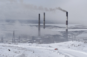 Chimneys from the smelters in the town of Nikel emit sulphur dioxide and other pollutants into the atmosphere. Kola Peninsula. NW Russia. 2005