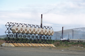 The town sign of Monchegorsk with the chimneys from nickel smelting behind. Kola Peninsula, NW Russia. 2005