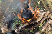 A kettle simmers above a fire at a Sami summer camp near Lovozero. Kola Peninsula, NW Russia. 2005