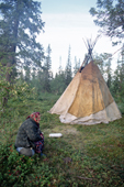 Anna Yurieva, a Sami woman from Lovozero, sits near her Lavo (tent) at a summer fishing camp. Kola Peninsula, NW Russia. 2005