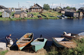 Boats on the river bank in the summer at Lovozero. Kola Peninsula, NW Russia. 2005