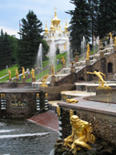 The Great Cascade, fountains and gilded statues, with the East Chapel in the background. Peterhof. Near St. Petersburg, Russia. 2010