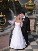 Wedding couple on a terrace, in the grounds of Peterhof Palace. Near St. Petersburg, Russia. 2010