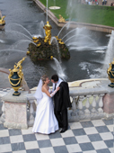 Wedding couple, with gilded fountains and the Great Canal behind. Peterhof Palace. Near St. Petersburg, Russia. 2010
