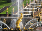 Gilded statues, including Samson rending open the jaws of the lion, and the Great Cascade at Peterhof Palace. Near St. Petersburg, Russia. 2010