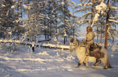 Pavel Sleptsov, a 35 year old hunter, on his horse at Korban in the winter time. Yakutia, Siberia, Russia.