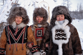 Three Evenk women dressed in traditional winter fur clothing. Kusur, Northern Yakutia, Siberia, Russia. 2001