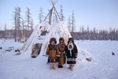 Three Evenk women dressed in traditional clothing at a reindeer herding camp near. Kusur, N.Yakutia, Siberia. 2001